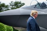 U.S. President Donald Trump stands with an F-35 on the South Lawn of the White House on July 23, 2018.