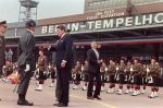 U.S. President Ronald Reagan, commemorating the 750th anniversary of Berlin, reviews honor guard of Royal Regiment of Scotland (wearing kilts) on June 12, 1987 after his landing at Berlin Tempelhof Airport.