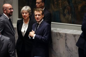 French President Emmanuel Macron waits with British Prime Minister Theresa May for the U.N. Security Council meeting on Iran on September 26, 2018 in New York City.