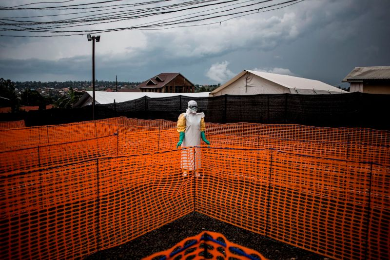 A health worker waits to handle an unconfirmed Ebola patient at a newly built, Médecins Sans Frontières-supported Ebola treatment center in Bunia, Democratic Republic of the Congo, on Nov. 7, 2018.