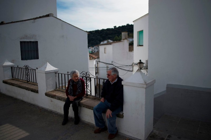 An elderly couple sit in Setenil de las Bodegas near Cádiz on Dec. 2, 2018, during Andalusia's regional election.