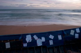 Handwritten notes are stuck on a boat used by migrants on Los Caños de Meca beach near Barbate, Spain, on Nov. 26, 2018.