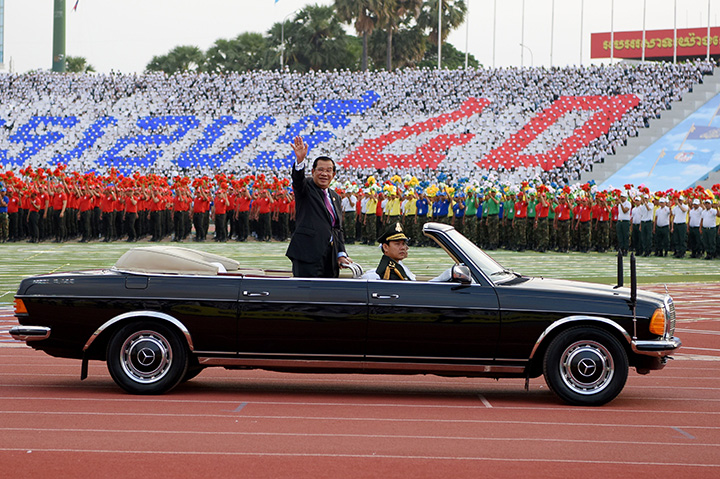 Cambodian Prime Minister Hun Sen waves during the Cambodian People's Party ceremony to mark the 40th anniversary of the fall of the Khmer Rouge regime in Phnom Penh on January 7.