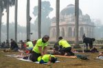 A group exercises in the smog near the tomb of Mohammed Shah at Lodhi Gardens in New Delhi on Jan. 12.