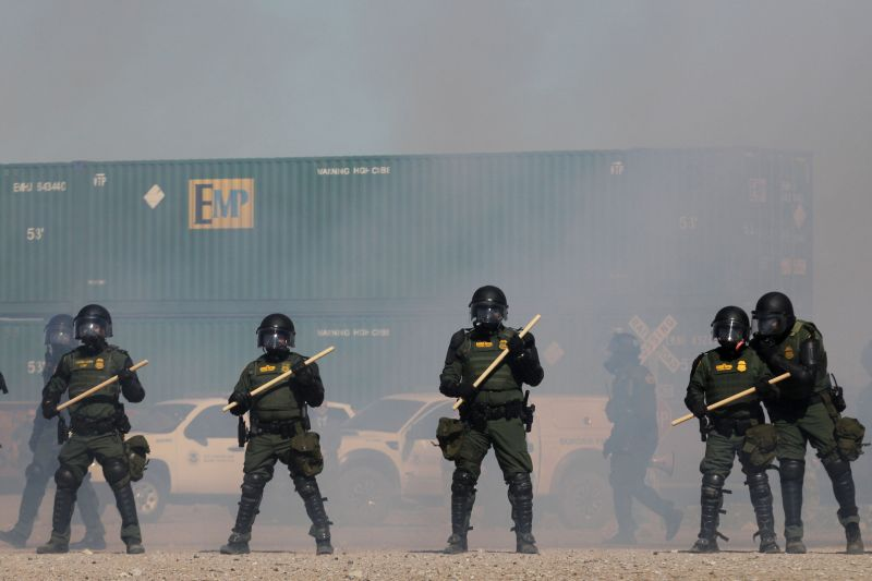 US Border Patrol, Immigration and Customs Enforcement (ICE) and Customs and Border Protection (CBP) agents take part in a safety drill in the Anapra area in Sunland Park, New Mexico, United States, across from Ciudad Juarez, Chihuahua state, Mexico, on Ja. 31.