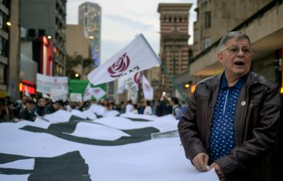 A former member of the Revolutionary Armed Forces of Colombia (FARC), now a member of the Common Alternative Revolutionary Force (FARC) party, takes part in a protest in Bogotá on March 18.