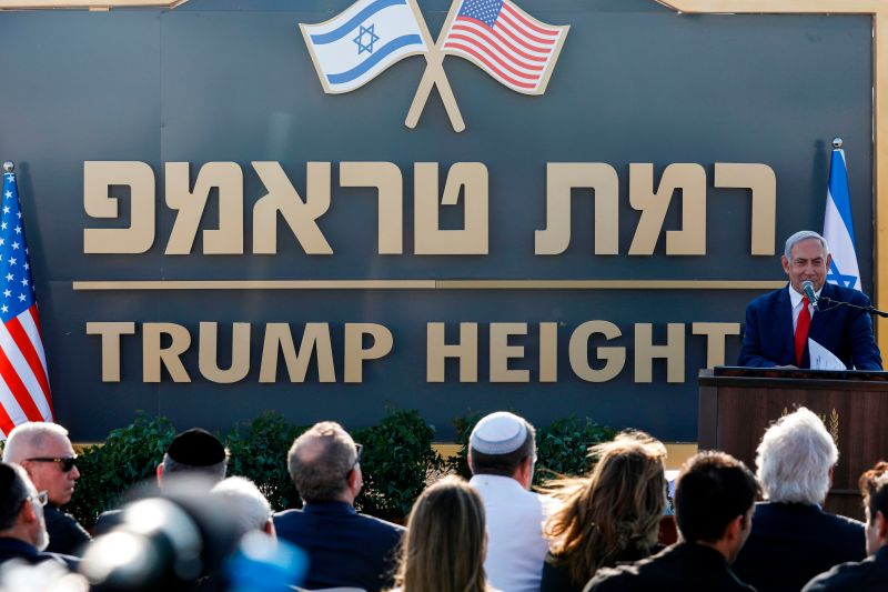 "Israeli Prime Minister Benjamin Netanyahu gives a speech before the newly-unveiled sign for the new settlement of ""Ramat Trump,"" or ""Trump Heights"" in English, named after the incumbent U.S. president during an official ceremony in the Israeli-annexed Golan Heights on June 16."