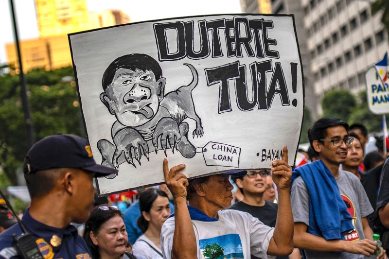 Filipinos protest in response to China's actions in the South China Sea and Philippine President Rodrigo Duterte's public statements in Manila on June 21.