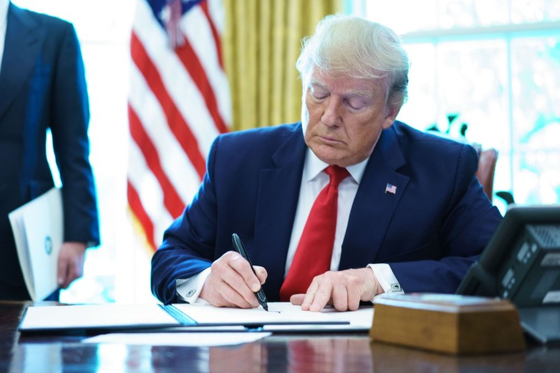 U.S. President Donald Trump signs an executive order on Iran sanctions in the White House on June 24.