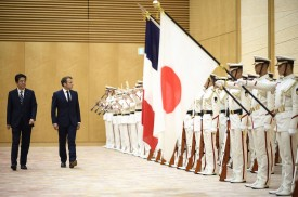 Japan's Prime Minister Shinzo Abe (L) walks with France's President Emmanuel Macron during an official ceremony at the prime minister's official residence in Tokyo on June 26, 2019. (Photo by Blondet Eliot / POOL / AFP)        (Photo credit should read BLONDET ELIOT/AFP/Getty Images)