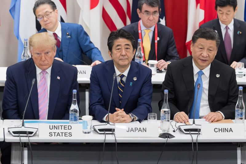 U.S. President Donald Trump sits next to Japanese Prime Minister Shinzo Abe and Chinese President Xi Jinping at the G-20 summit in Osaka, Japan, on June 28.