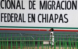 A migrant child is pictured in front of the Mexican National Institute of Migration in Tapachula,  near the Guatemalan border, on June 28.