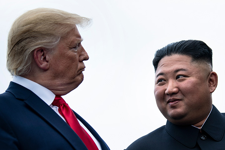 U.S. President Donald Trump and North Korea's leader Kim Jong-un talk before a meeting in the Demilitarized Zone (DMZ) on June 30.