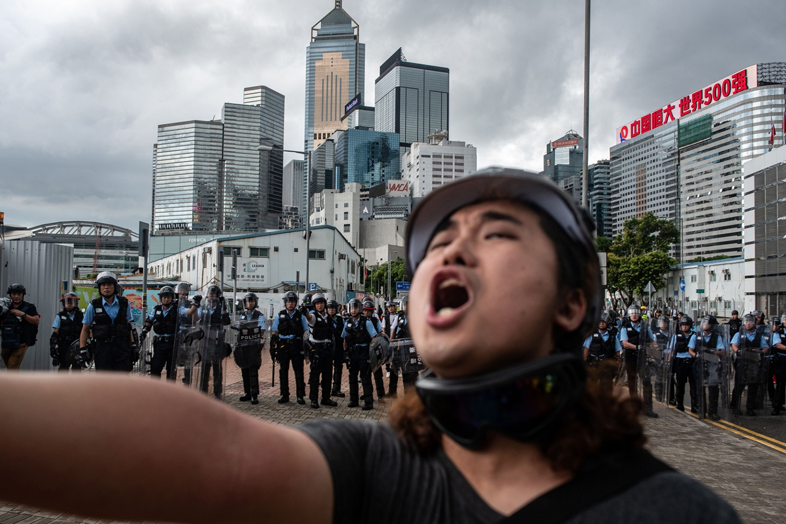 A protester shouts in front of police outside the government headquarters after the annual flag-raising ceremony to mark the 22nd anniversary of the city's handover from Britain to China in Hong Kong on July 1. PHILIP FONG/AFP/Getty Images