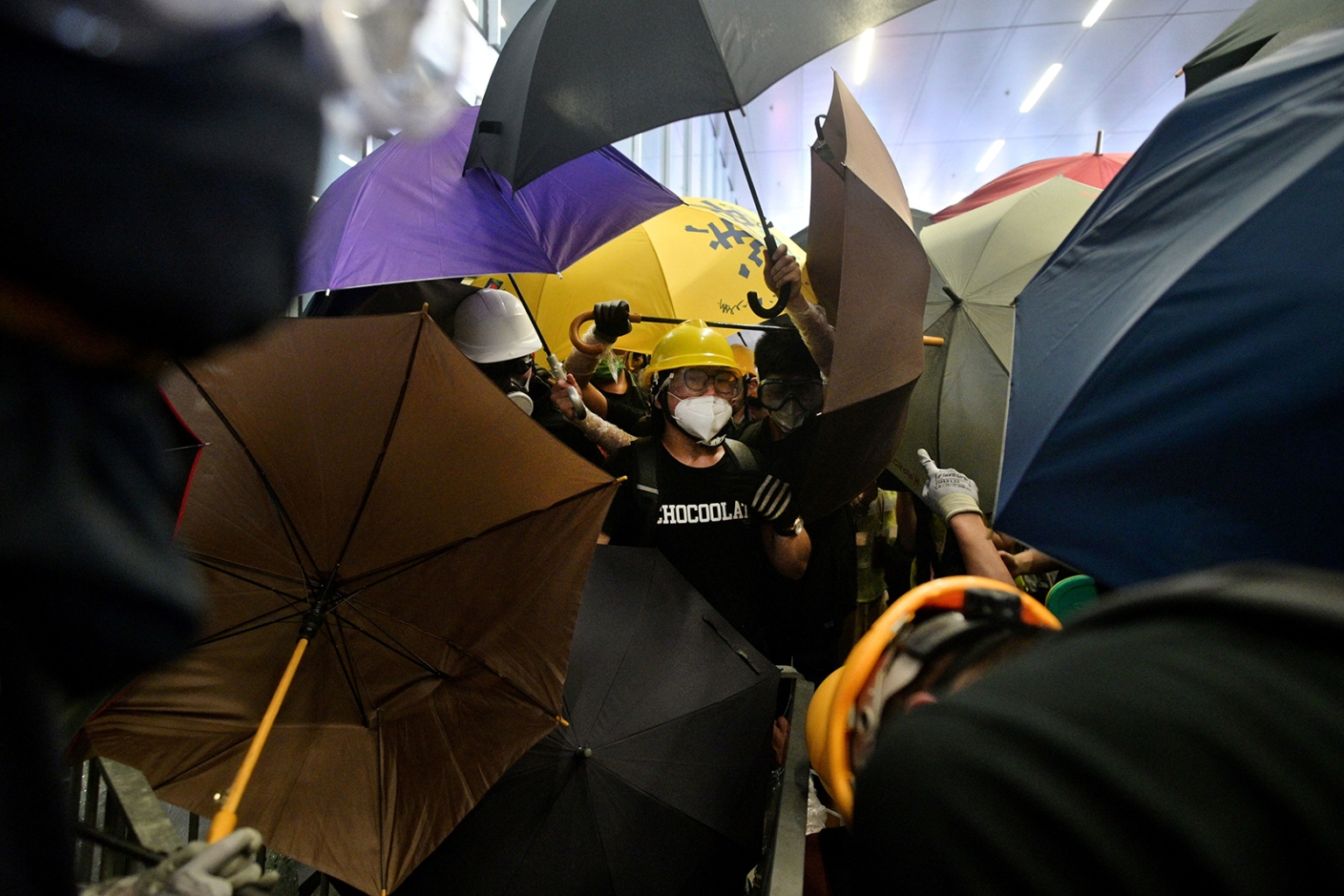 Protesters attempt to smash windows at the government headquarters in Hong Kong on July 1. ANTHONY WALLACE/AFP/Getty Images