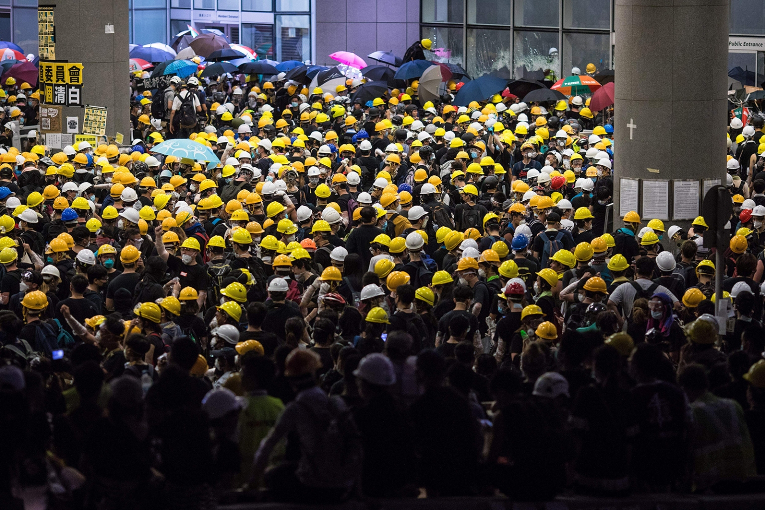 A crowd of protesters gather outside the government headquarters in Hong Kong on July 1, before storming the   parliament, ransacking the building, and daubing its walls with graffiti. DALE DE LA REY/AFP/Getty Images