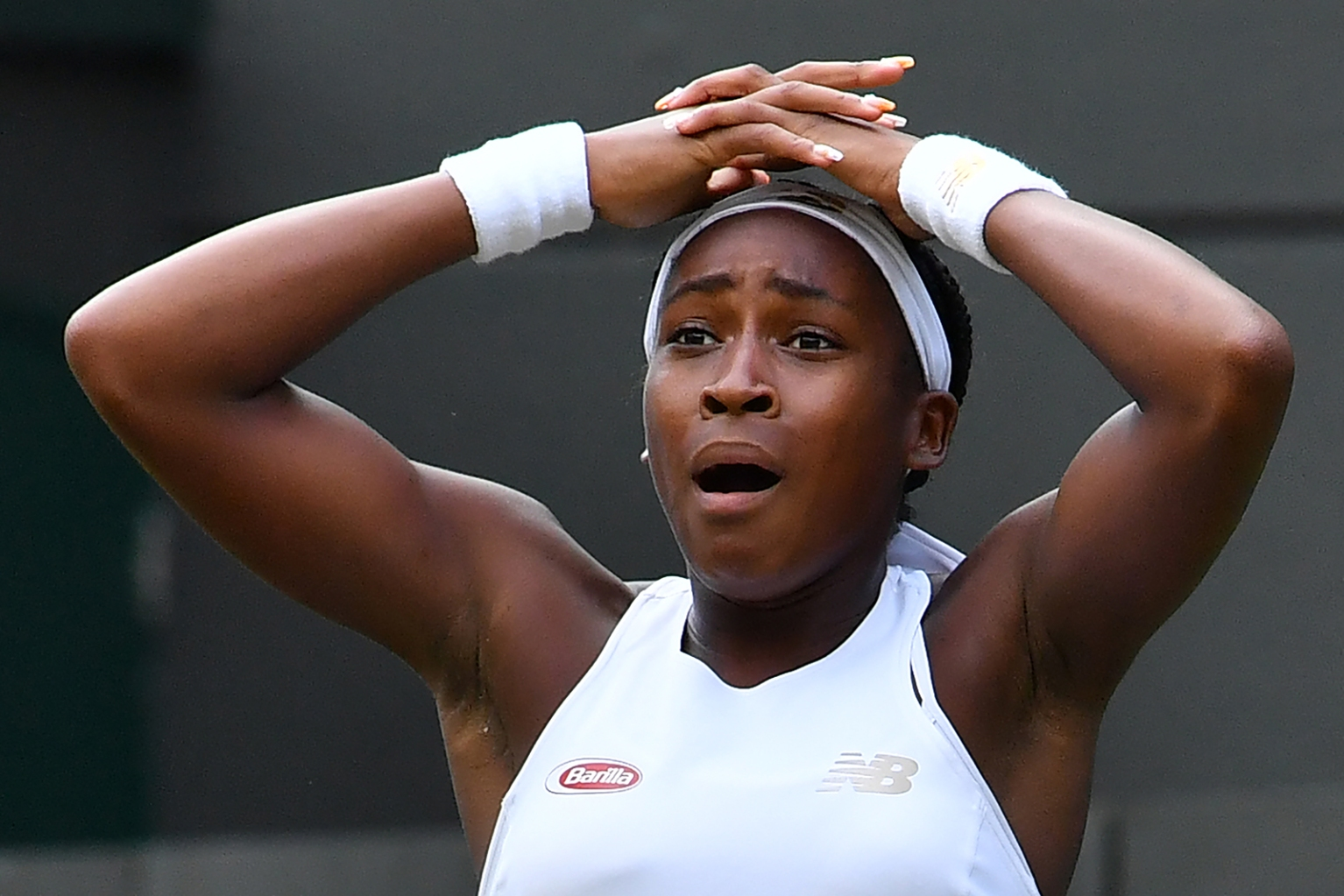 U.S. player Cori Gauff, a 15-year-old tennis prodigy who grew up idolizing he Williams sisters, celebrates beating Venus Williams during their women's singles first round match at Wimbledon on July 1. BEN STANSALL/AFP/Getty Images
