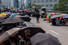 Protesters rest on the road on July 2 in Hong Kong, China.