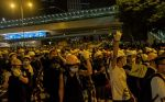 Protesters confront police after the Legislative Council building was damaged in Hong Kong on July 2.