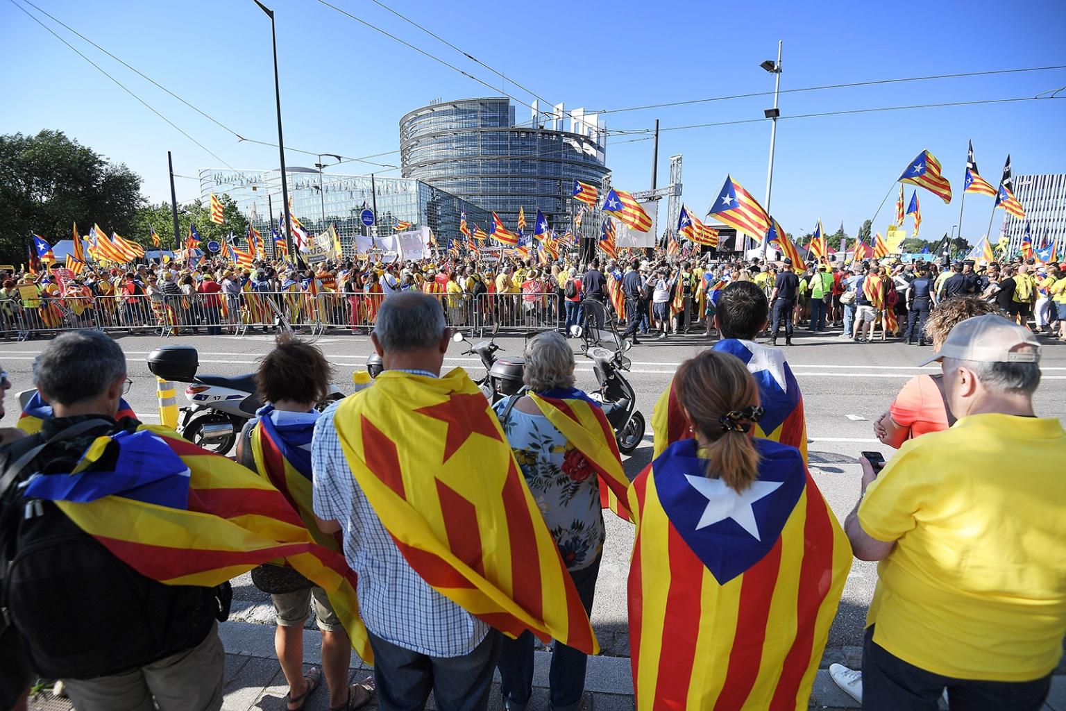 People wave Catalan pro-independence flags during a demonstration in front of the European Parliament in Strasbourge, France, on July 2. FREDERICK FLORIN/AFP/Getty Images