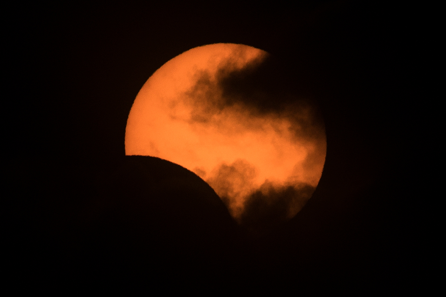 The solar eclipse as seen from Congreso neighborhood in Buenos Aires, Argentina, on July 2. ALEJANDRO PAGNI/AFP/Getty Images