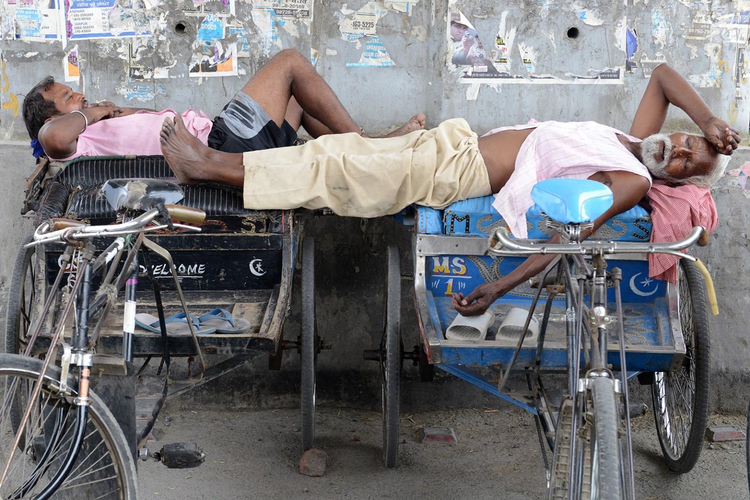 Indian cycle rickshaw drivers take a nap under a flyover bridge during a hot summer day in Amritsar, India, on July 3. NARINDER NANU/AFP/Getty Images