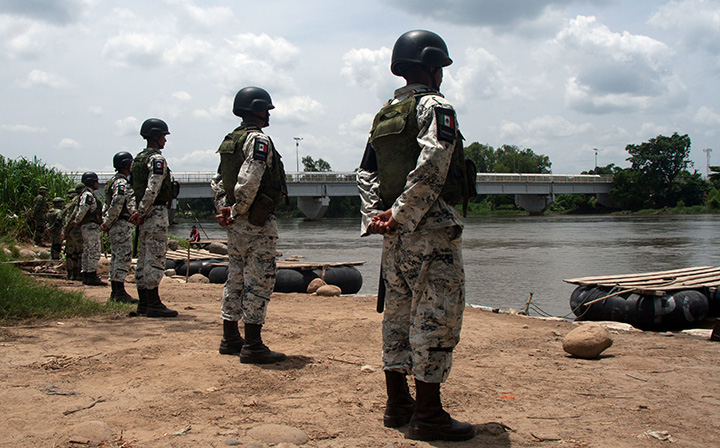 Mexican National Guard members stand watch along the banks of the Suchiate River to prevent crossings to and from Tecun Uman in Guatemala, on July 3.