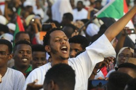 People celebrate after protest leaders strike a deal with the ruling generals on a new governing body in Khartoum on July 5.