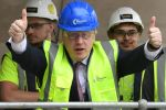 Conservative Party leadership candidate Boris Johnson gestures during a visit to the construction project to expand Terminal Two at Manchester Airport in England on July 9.