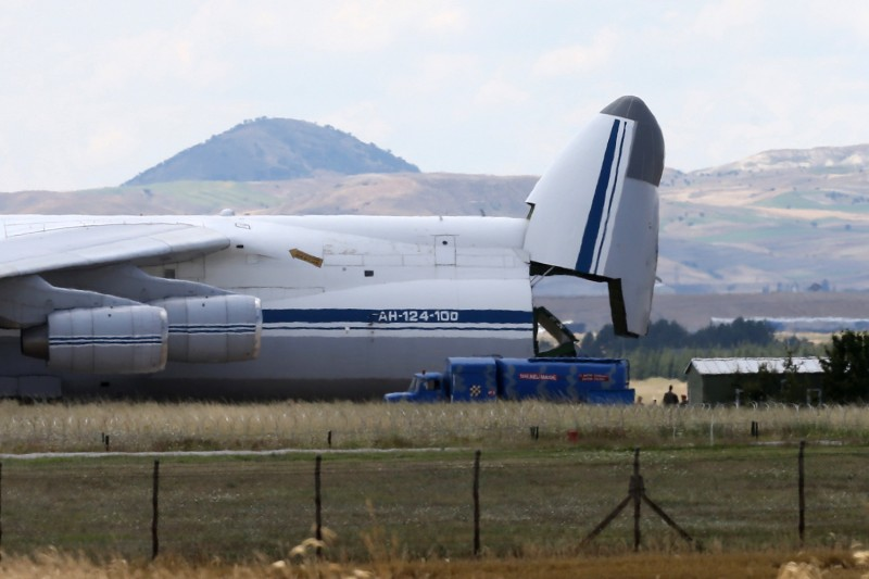 A Russian Antonov military cargo plane, carrying the S-400 missile system from Russia, is unloaded after landing at the Murted military airbase in Ankara on July 12, 2019.