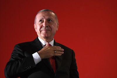 Turkish President Recep Tayyip Erdogan greets supporters during a third anniversary commemoration rally of the country's coup in Istanbul on July 15.