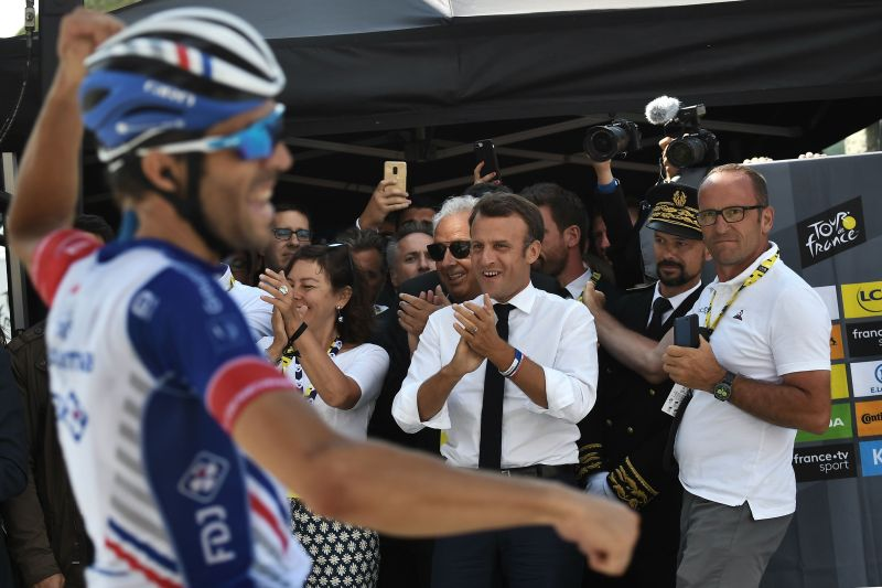 French President Emmanuel Macron applauds France's Thibaut Pinot winning on the finish line of the fourteenth stage of the 106th edition of the Tour de France cycling race between Tarbes and Tourmalet Bareges, in Tourmalet Bareges on July 20, 2019.