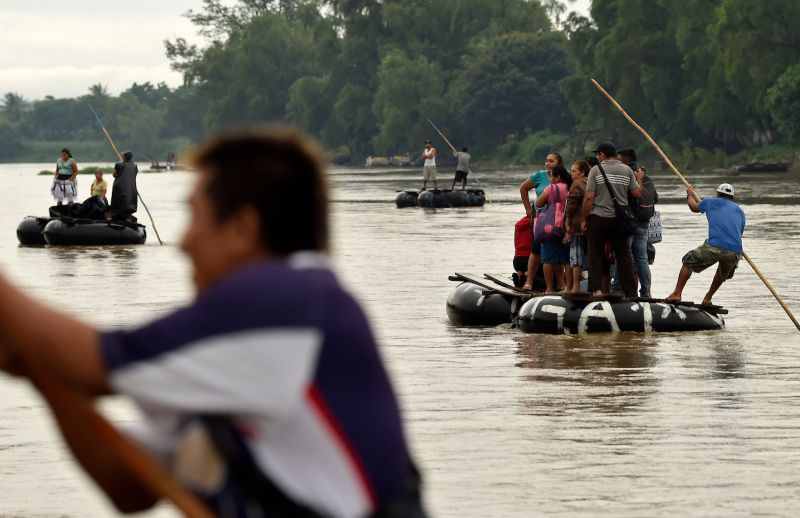 Guatemalan migrants use makeshift rafts to cross the Suchiate River from Tecún Umán in Guatemala to Ciudad Hidalgo in Chiapas State, Mexico, on July 22.