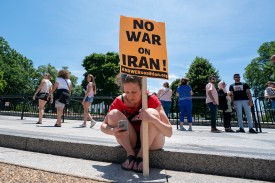 Protesters gather in front of the White House to speak out against a possible war with Iran on June 23.