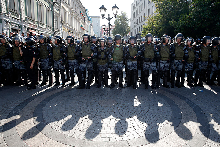 Russian National Guard members block a street during and rally demanding independent and opposition candidates be allowed to run for local office in downtown Moscow on July 27.