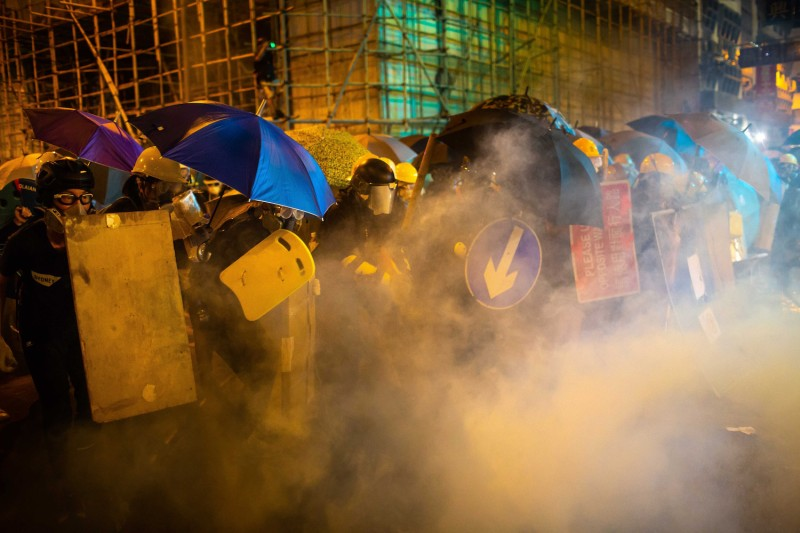 Protesters are enveloped by tear gas during a demonstration in Hong Kong's Sheung Wan district on July 28.