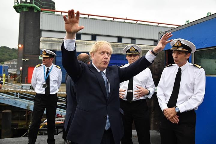 Britain's Prime Minister Boris Johnson gestures as he visits the HMS Victorious on July 29 in Faslane, Scotland.