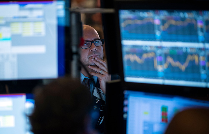 Traders work after the opening bell at the New York Stock Exchange  on July 29 in New York City.