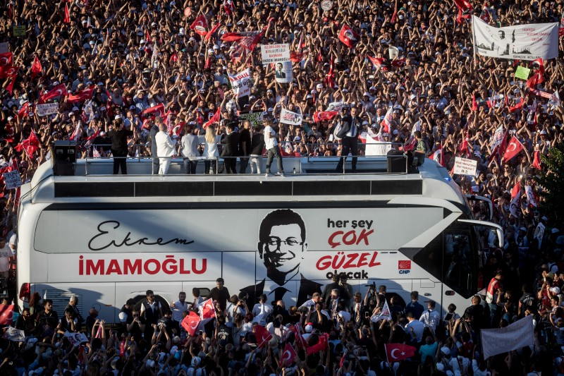 Ekrem Imamoglu, the newly elected mayor of Istanbul, speaks to supporters after taking the mayoral mandate in front of the Istanbul municipality building on June 27.