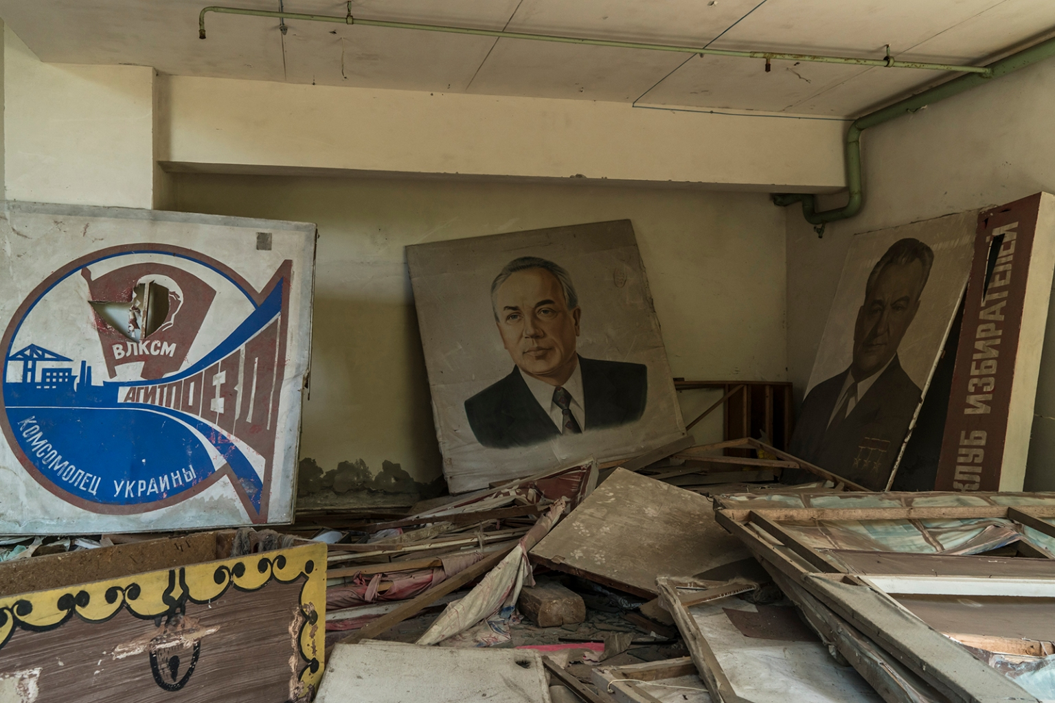 Posters and portraits rest in an abandoned building in Pripyat, Ukraine, inside the Chernobyl Exclusion Zone, on July 2. Brendan Hoffman/Getty Images