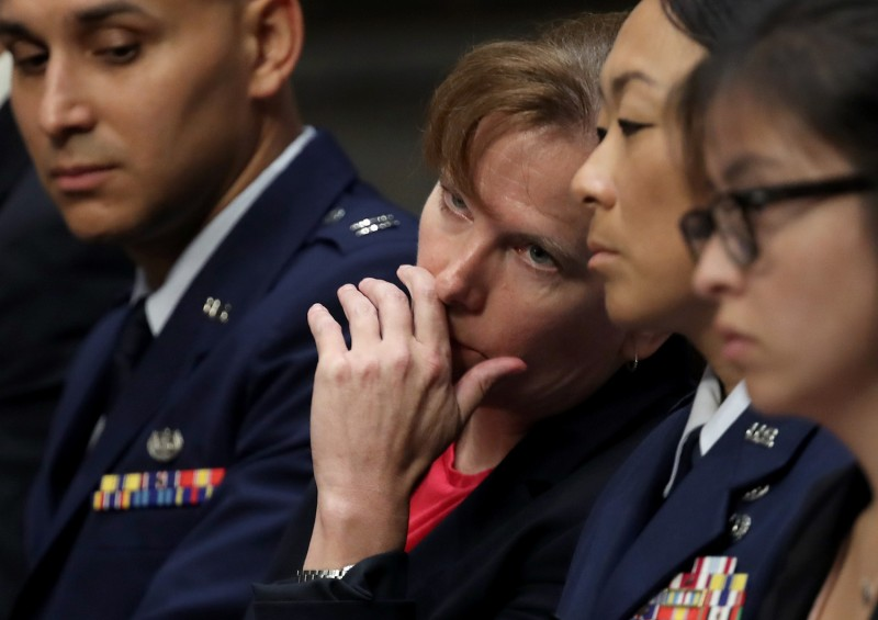 U.S. Army Col. Kathryn Spletstoser confers with a colleague as U.S. Air Force Gen. John Hyten testifies before the Senate Armed Services Committee on his appointment as the next vice chairman of the Joint Chiefs of Staff in Washington on July 30.