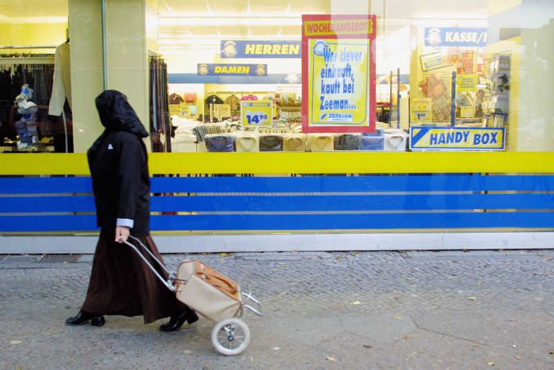 A Muslim woman passes a shop October 10, 2001 in Berlin's heavily-Muslim Neukoelln district.