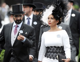Sheikh Mohammed Bin Rashid Al Maktoum and Princess Haya Bint Al Hussein of Jordan attend the Royal Ascot race in England on June 19, 2014.