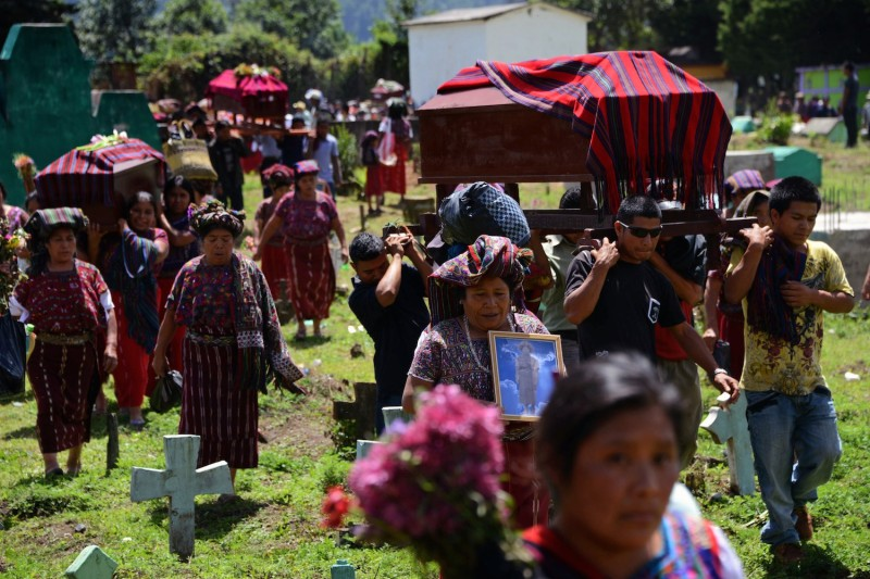 Guatemala's Ixil people at burial of victims of Guatemala's 1982 civil war massacre, in the Quiche village of Nebaj on July 30, 2014.