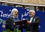 Iranian President Hassan Rouhani awards Foreign Minister Mohammad Javad Zarif with the Medal of Honour for his role in the implementation of a nuclear deal with world powers, on Feb. 8, 2016, in Tehran.