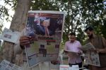 Pakistani residents read newspapers with coverage of Donald Trump's victory in the U.S. presidential election in Islamabad on Nov. 10, 2016.