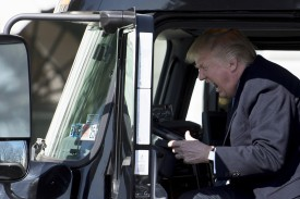 U.S. President Donald Trump sits in the driver's seat of a semi-truck as he welcomes truckers and CEOs to the White House to discuss health care on March 23, 2017.