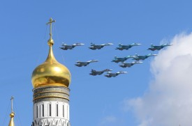 Russian Sukhoi Su-35 and Su-34 military aircrafts fly above the Ivan the Great Bell Tower during a rehearsal for the Victory Day military parade in central Moscow on May 4, 2017. (NATALIA KOLESNIKOVA/AFP/Getty Images)