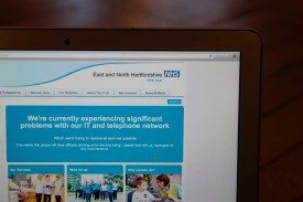 This photograph, posed as an illustration on May 12, 2017, shows the website of the NHS: East and North Hertfordshire notifying users of the aftermath of a cyberattack on its network taken in London.