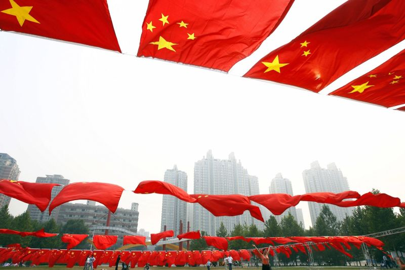 Chinese flags are displayed in Chaoyang Park in Beijing on Sept. 30, 2006.